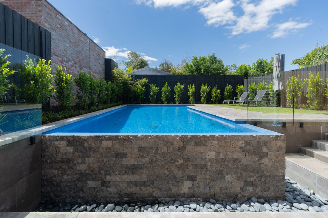 Neptune Swimming Pools stacked stone Sydney pool builder
