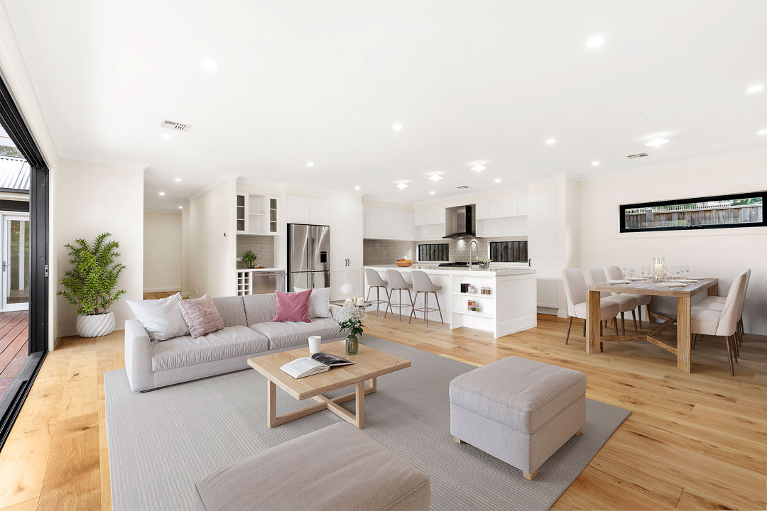 Busby Homes living room with timber floor and grey furnishings