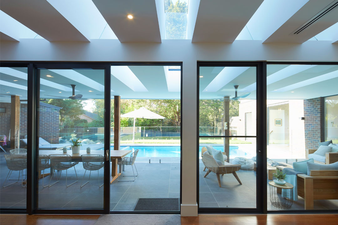 Englehart Homes glass doors looking onto pool