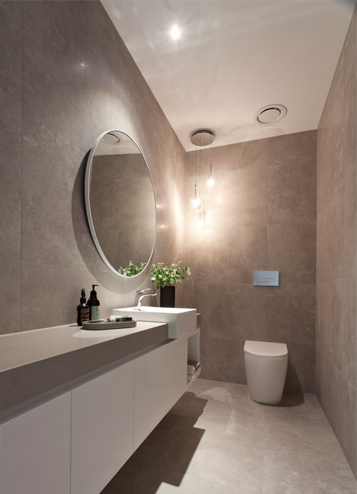 Rahcon bathroom with grey floor and wall tiles
