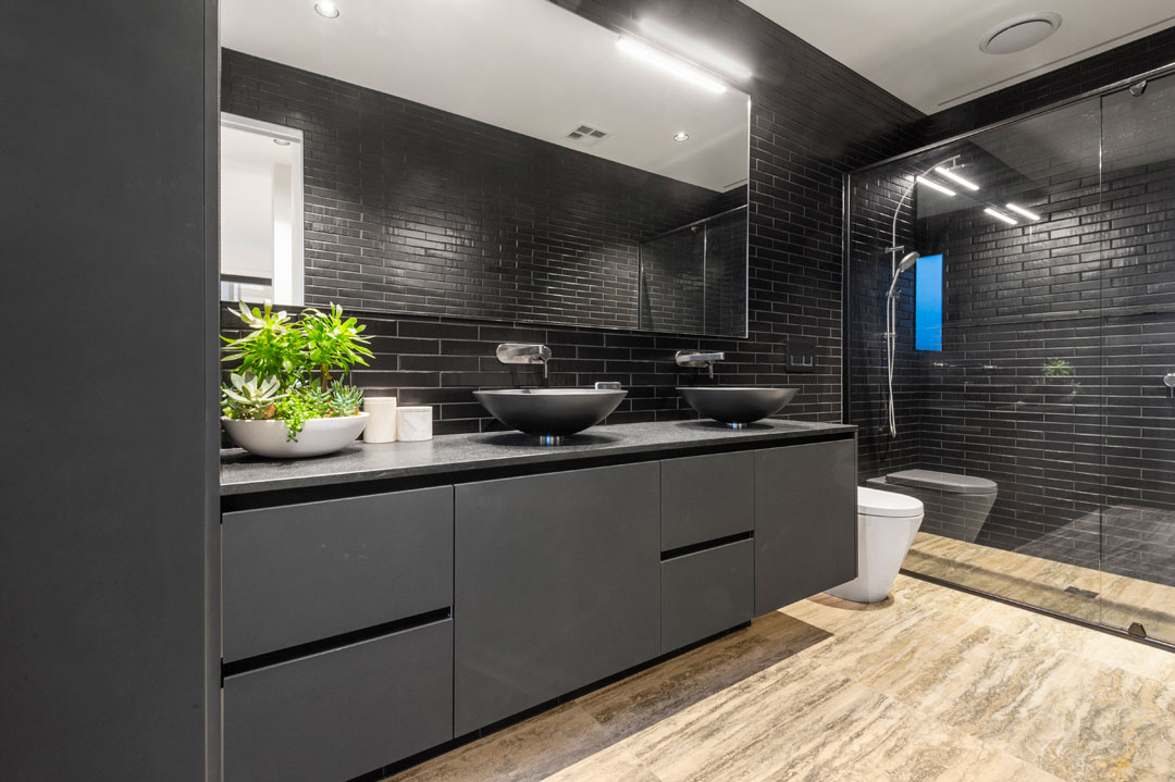 Envirotec Homes bathroom with black cabinetry and black tiles